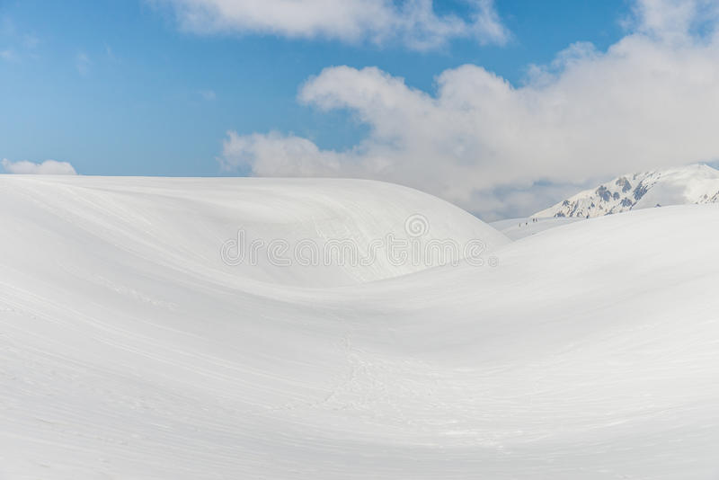Snow hills against clear blue sky. Panoramic view of Mountains in Murodo, Tateyama Kurobe Alpine Route ,Japan stock photography