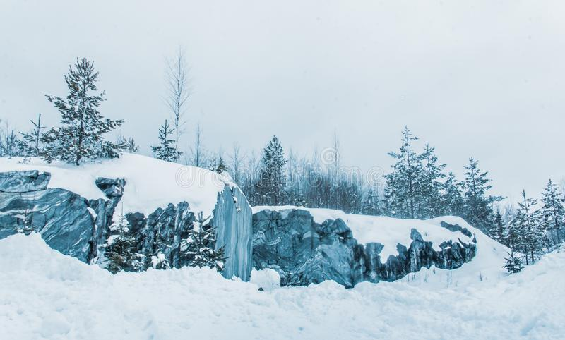 Snow and ice of beautiful Karelia. Somewhere in Russia. Forest in the snow. Beautiful time of year. Purity of nature. Marble fairy tale. marble canyon, marble royalty free stock image