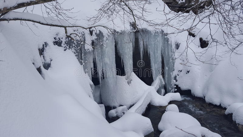 Snow and ice cover cave stock photography