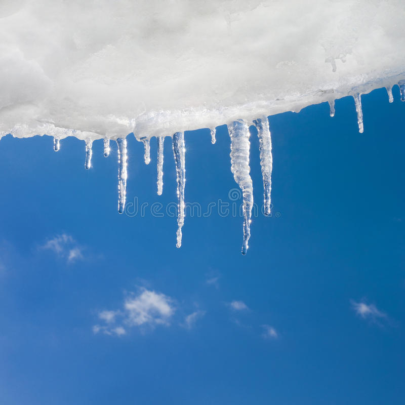 Snow and icicles royalty free stock photos