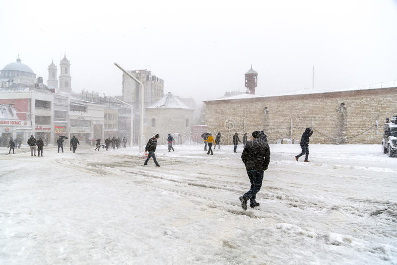 Snow in Istanbul. Istanbul, Turkey - January 10, 2017: Istanbul under heavy snow on January 10. The locals and visitors enjoy walking on snow on Istiklal Avenue stock images