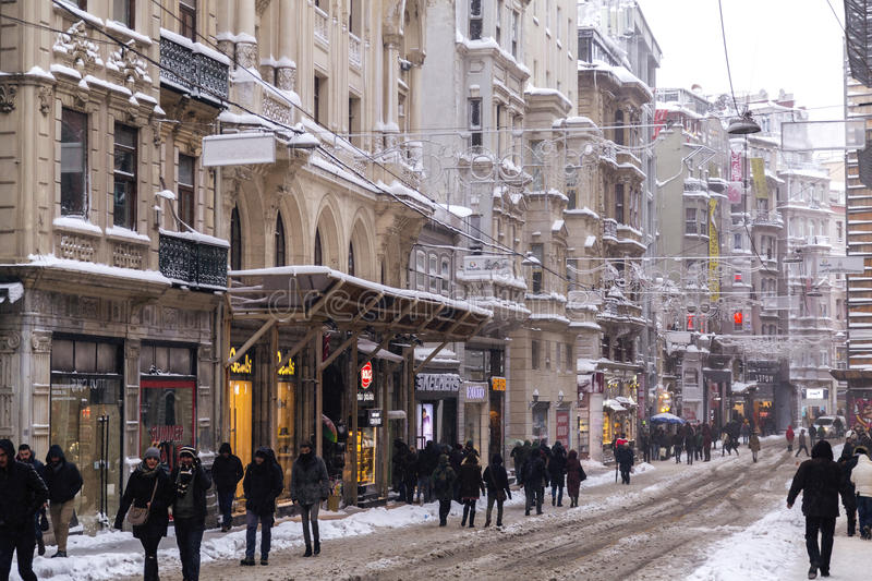 Snow in Istanbul. Istanbul, Turkey - January 10, 2017: Istanbul under heavy snow on January 10. The locals and visitors enjoy walking on snow on Istiklal Avenue royalty free stock images