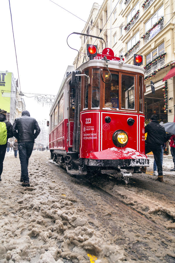 Snow in Istanbul. Istanbul, Turkey - January 10, 2017: Istanbul under heavy snow on January 10. The locals and visitors enjoy walking on snow on Istiklal Avenue stock photo