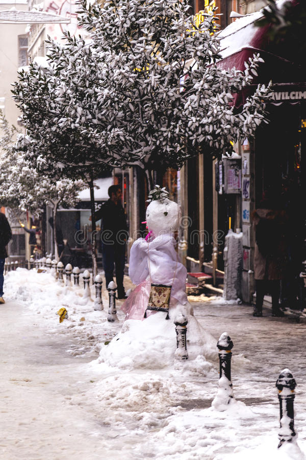 Snow in Istanbul. Istanbul, Turkey - January 10, 2017: Istanbul under heavy snow on January 10. The locals and visitors enjoy walking on snow on Istiklal Avenue stock photos