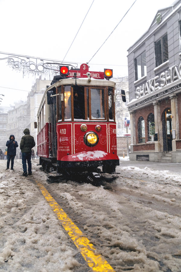 Snow in Istanbul. Istanbul, Turkey - January 10, 2017: Istanbul under heavy snow on January 10. The locals and visitors enjoy walking on snow on Istiklal Avenue stock image