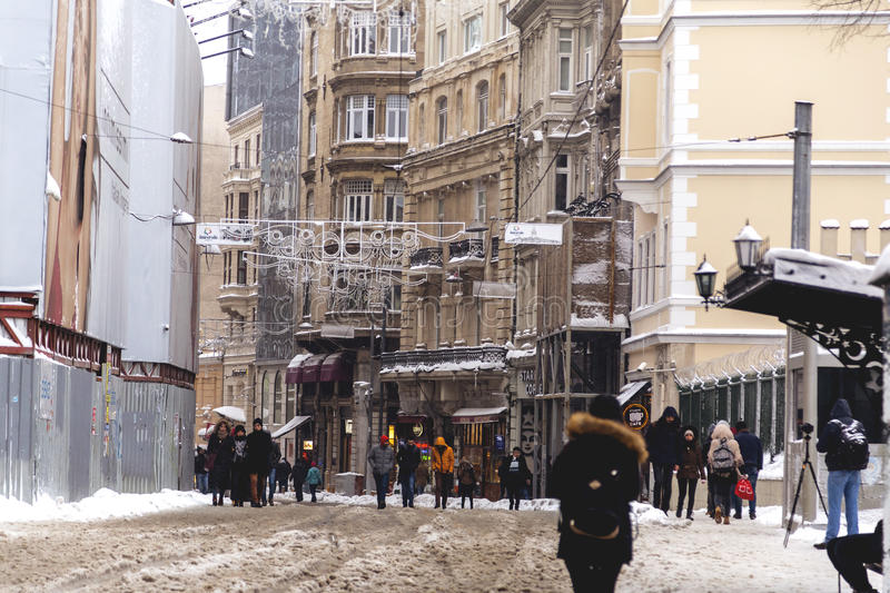 Snow in Istanbul. Istanbul, Turkey - January 10, 2017: Istanbul under heavy snow on January 10. The locals and visitors enjoy walking on snow on Istiklal Avenue royalty free stock photos
