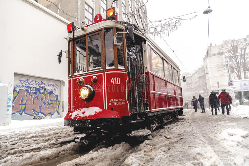 Snow in Istanbul. Istanbul, Turkey - January 10, 2017: Istanbul under heavy snow on January 10. The locals and visitors enjoy walking on snow on Istiklal Avenue royalty free stock image