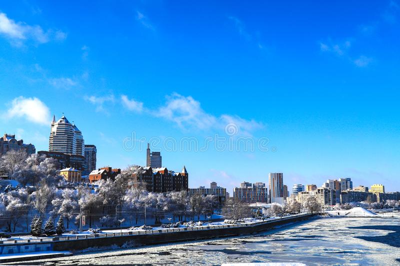 Snow landscape of the Dnipro city. View of the buildings, skyscrapers, Dnieper river and towers in winter, Ukraine, stock image