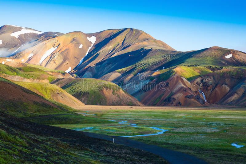 Snow lies in colorful rhyolite mountains stock photos