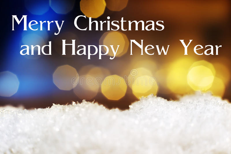 Snow with lights Merry Christmas Happy New Year. Image of artificial snow and bokeh lights in background and text Merry Christmas and Happy New Year stock photography