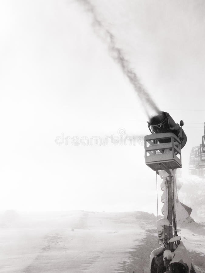 Snow machine making artificial snow stock photography