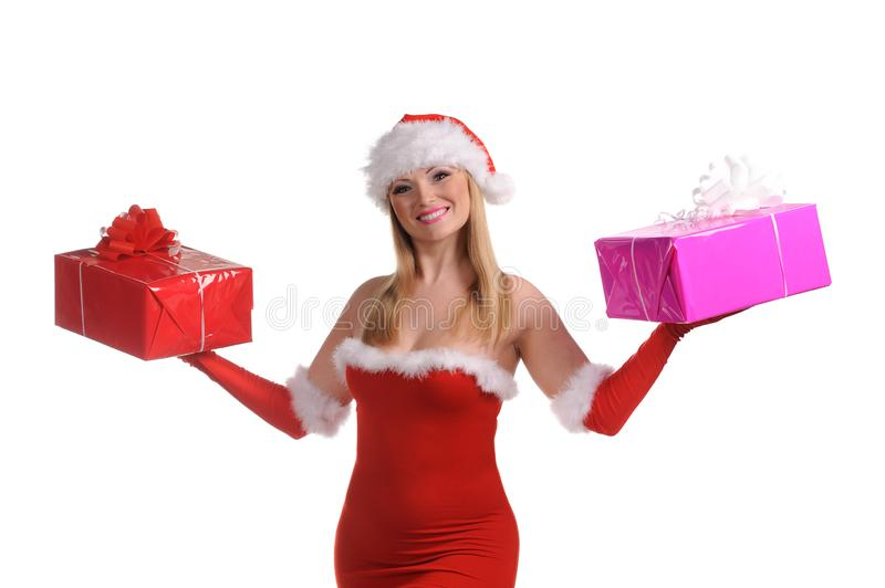 Snow Maiden in the red dress with gift boxes in the hands. Isolated over white background royalty free stock photo