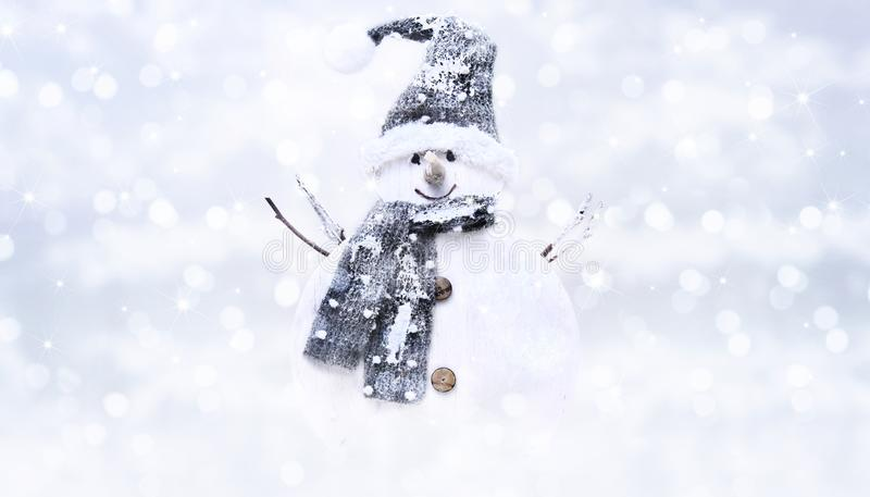 Snow man on blurred bright christmas lights background, greeting. Card and banner template with copy space stock photography