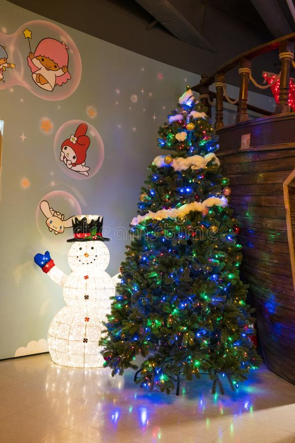 Snow man and christmas tree in Hello Kitty Island. Jeju, Korea, 9th, March, 2019. Snow man and christmas tree in Hello Kitty Island. It`s a colorful and rich stock photography
