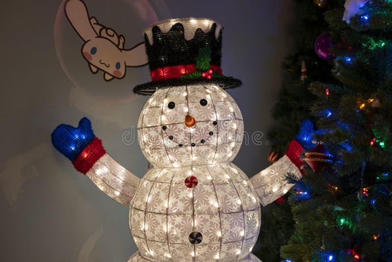 Snow man and christmas tree in Hello Kitty Island. Jeju, Korea, 9th, March, 2019. Snow man and christmas tree in Hello Kitty Island. It`s a colorful and rich stock photos