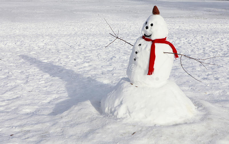 Snow Man with Red Scarf. Traditional Snow Man with Red Scarf stock photography