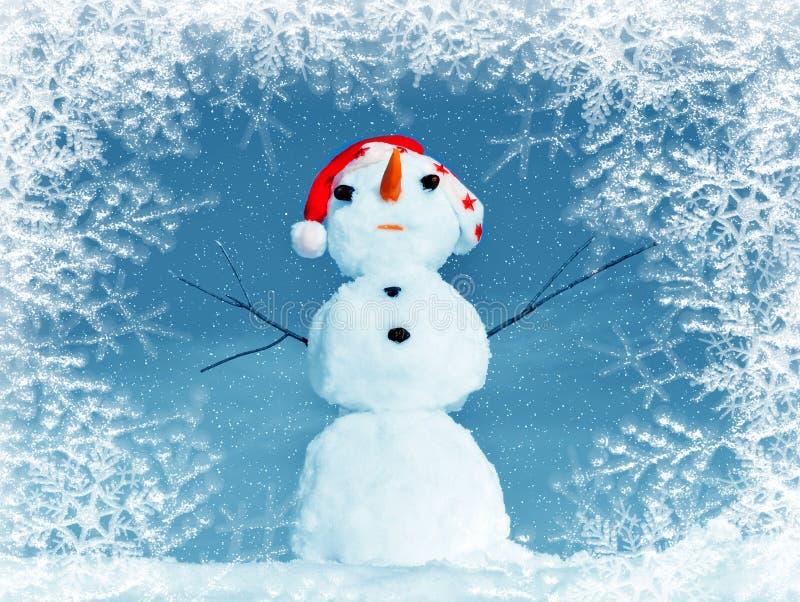Snow man in santa cap in frame