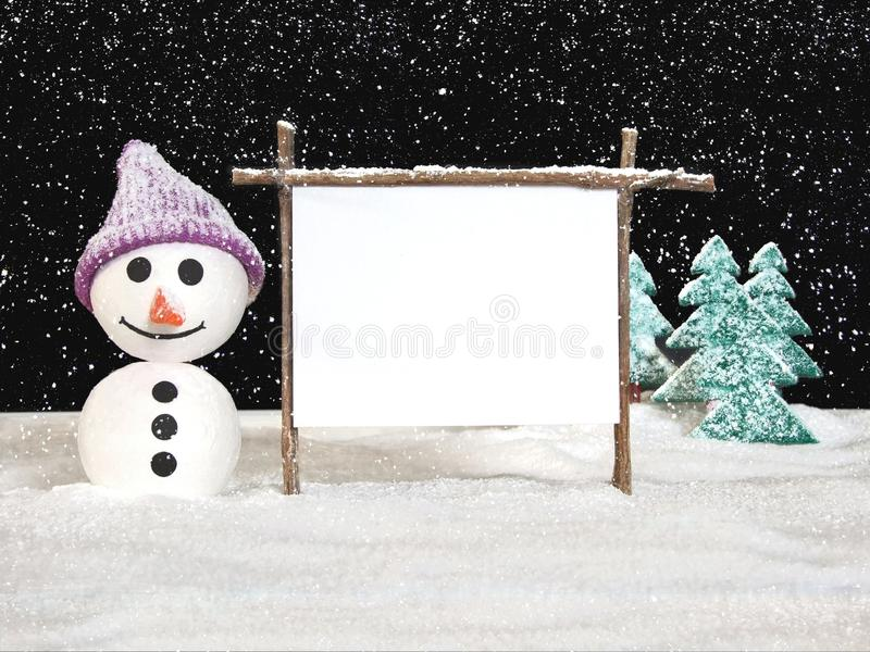 Snow man with sign stock image