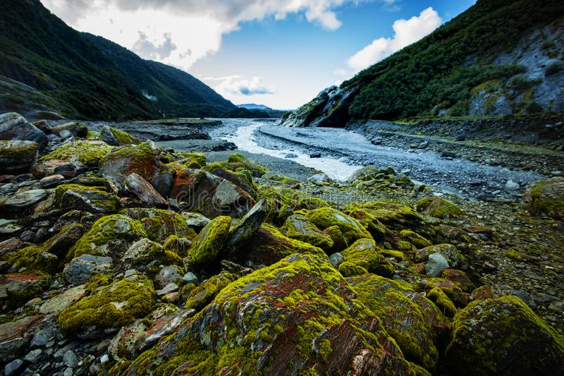Snow melting creek in franz josef glacier southland new zealand royalty free stock images