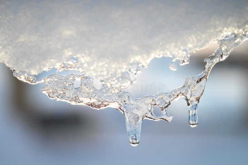 Snow melting icicle spring background stock photo