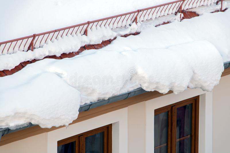 Snow melting on the roof royalty free stock images