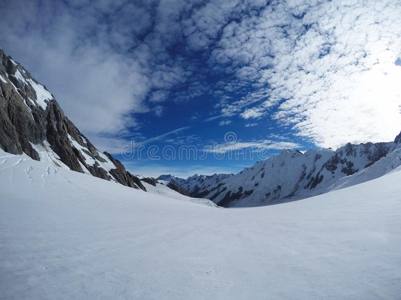Snow/mountain background for mountain lovers. Contrast of white snow and blue sky on the Tasman Glacier at Aoraki/Mount Cook Natio. Nal Park, New Zealand. Alpine royalty free stock images