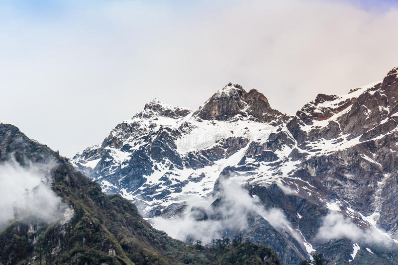 Snow mountain with fog royalty free stock photography