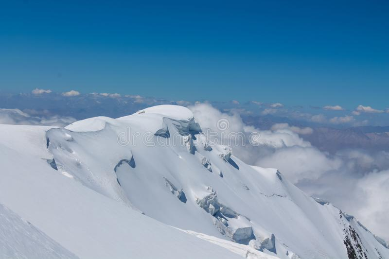 Snow of mountain glacier in Himalaya summit ascent. Snow of mountain glacier, climbing alpinist route. Alpinist with equipment iceaxe, crampons, helmet and rope royalty free stock images