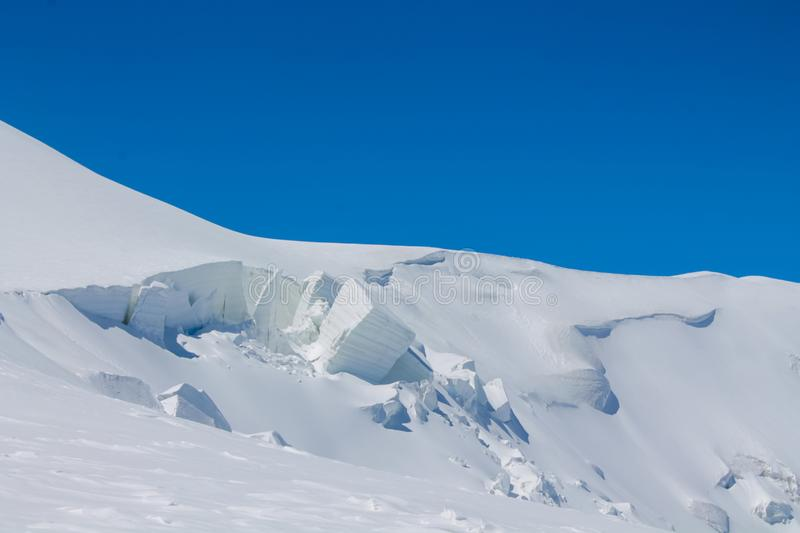 Snow of mountain glacier in Himalaya summit ascent. Snow of mountain glacier, climbing alpinist route. Alpinist with equipment iceaxe, crampons, helmet and rope stock photo