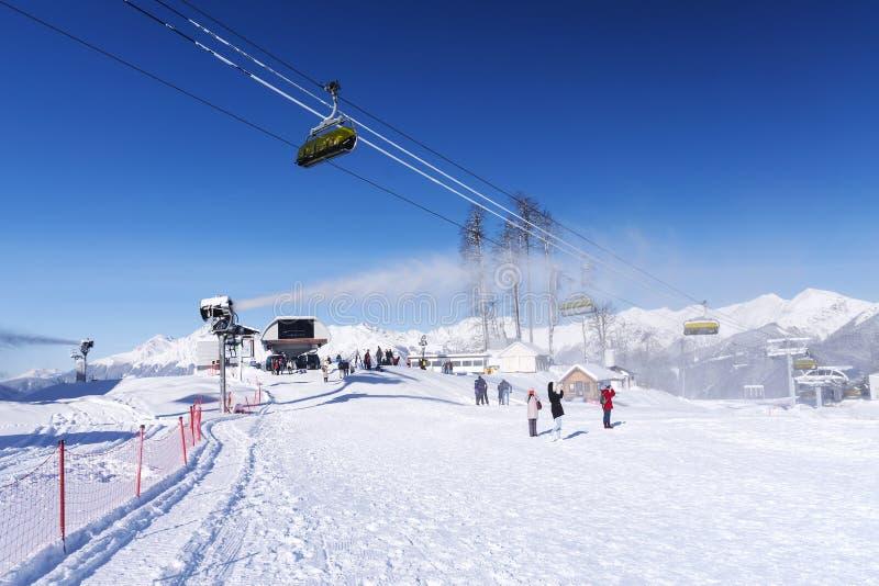 Snow mountain glade with ski lifts stock photos