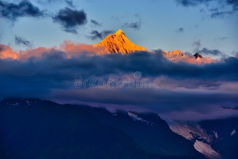 Golden snow mountain stock image