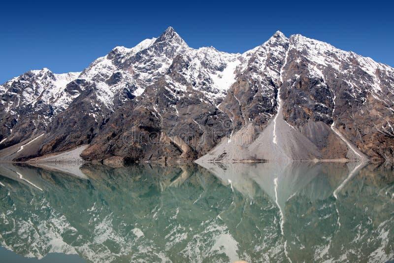 Snow mountain & lake stock photo