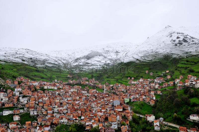 Snow mountain over the village. Hillside in Shar Mountain, Kosovo royalty free stock photos