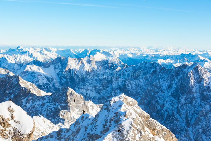 Snow Mountain Range Landscape with Blue Sky from Zugspitze Mountain in Germany stock photography