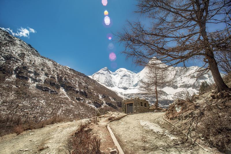 Snow mountain range with pathway of trail route to frozen milk lake and Five colors lake at Yading Nature Reserve,China royalty free stock photo