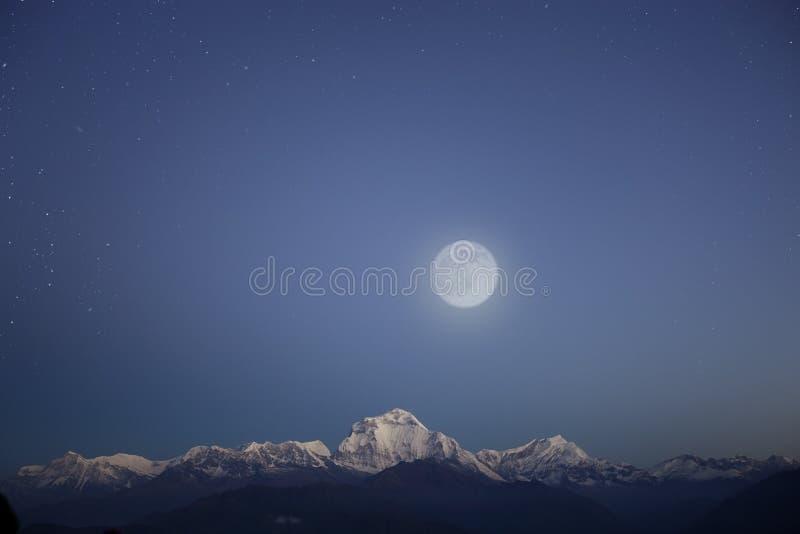 Snow mountain range under stars sky royalty free stock photo