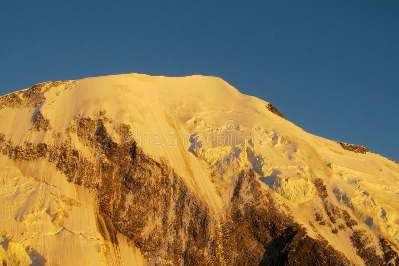 Snow mountain summit at sunset. Snow mountain summit in the Alps at sunset royalty free stock photo