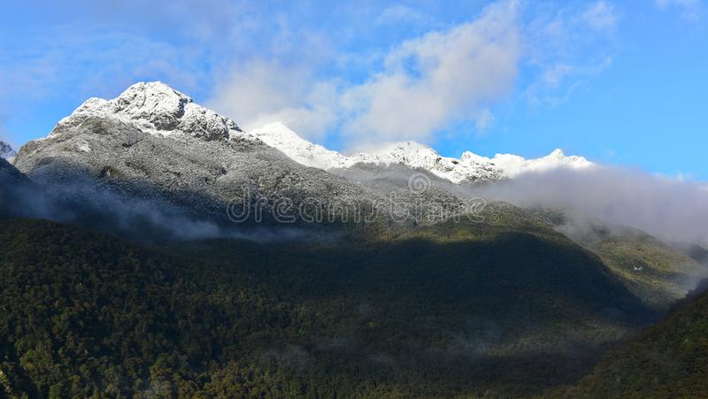 Snow mountains as viewed from Wilmot Pass in Fiodland National Park, New Zealand royalty free stock images