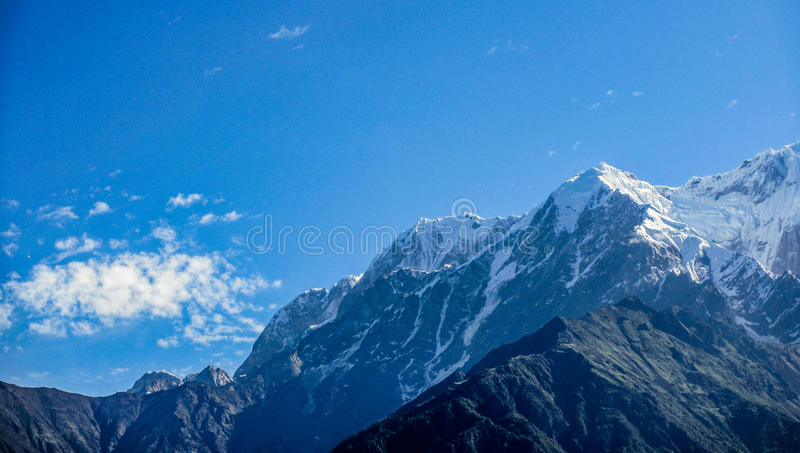 Snow mountains with blue sky stock image