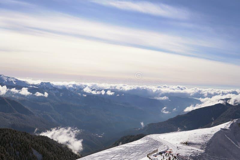 Snow mountains, blue sky winter ski resort. Snow mountains, blue sky winter ski royalty free stock photo