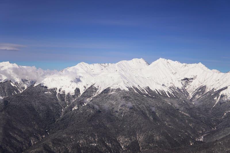 Snow mountains, blue sky winter ski resort. Snow mountains, blue sky winter ski stock image