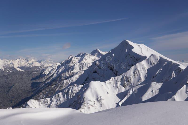 Snow mountains, blue sky winter ski resort. Snow mountains, blue sky winter ski stock photo