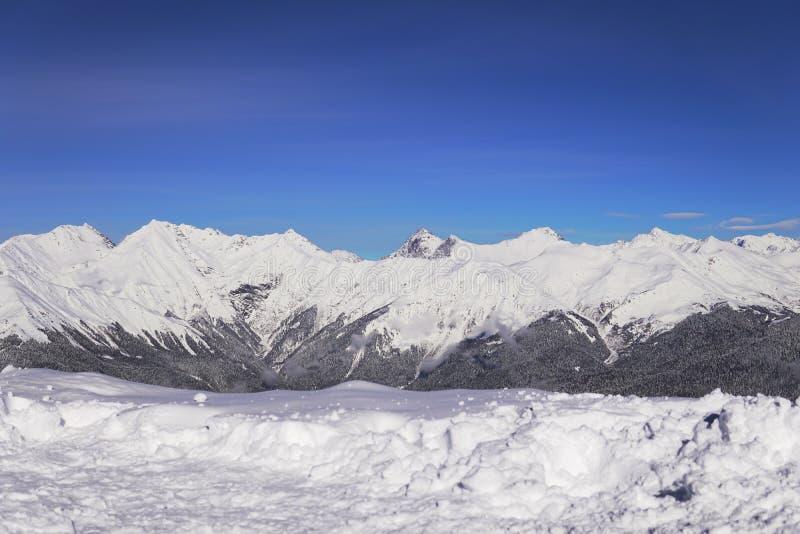 Snow mountains, blue sky winter ski resort. Snow mountains, blue sky winter ski stock photos