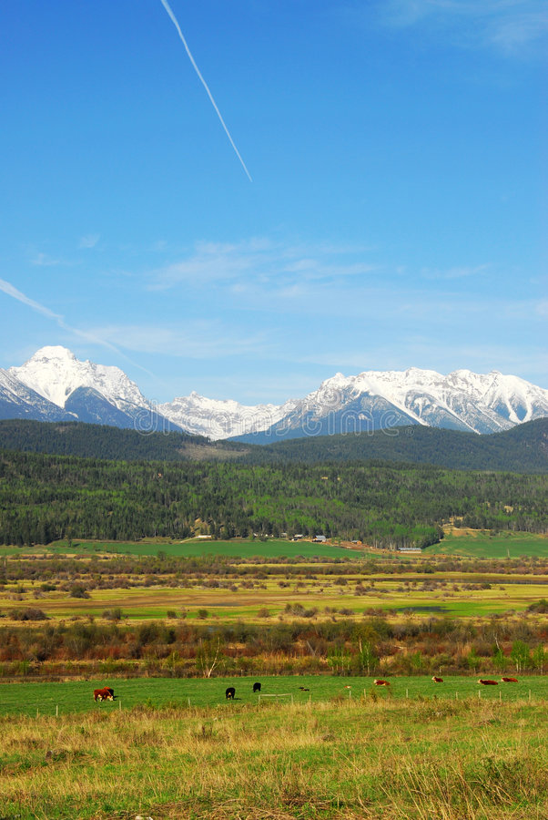 Download Snow Mountains And Farms Royalty Free Stock Photos - Image: 5306578