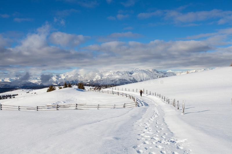 Snow mountains and blue sky in south tirol winter travel lands royalty free stock photo