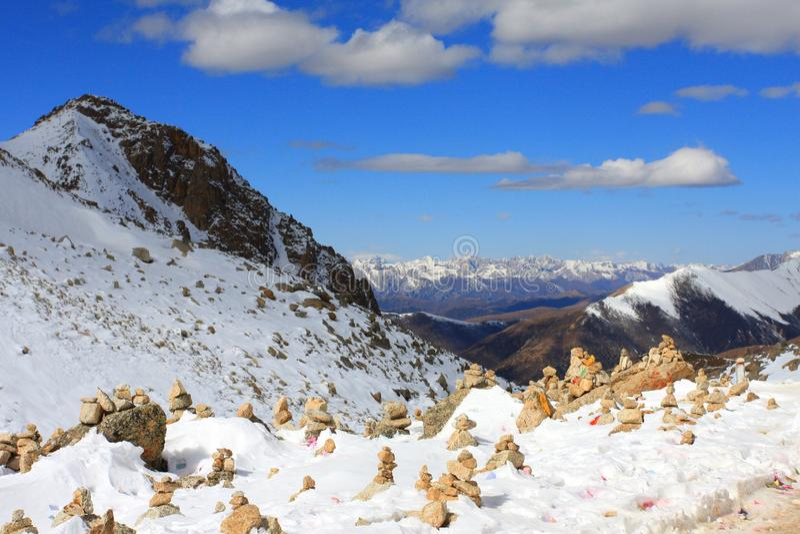 Snow mountains and Mani piles in Tibet stock photo