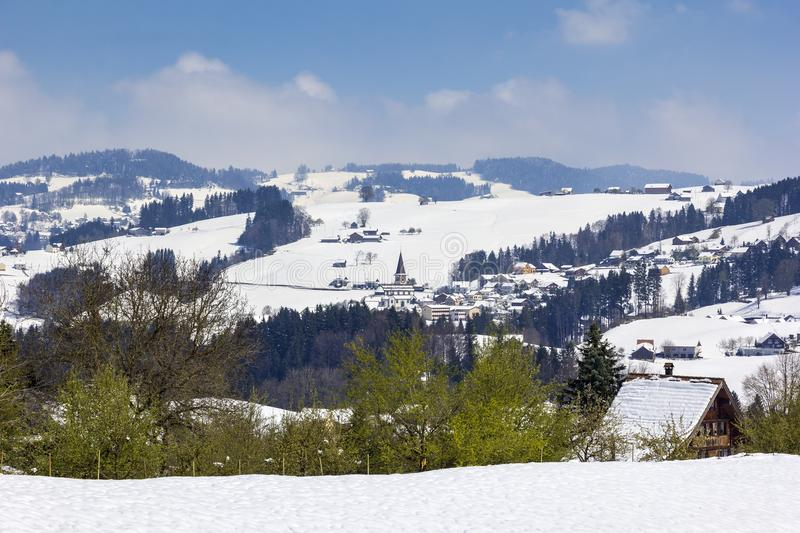 Snow in the mountains, but springtime is coming. In the European Alps, Appenzell, Switzerland royalty free stock photos