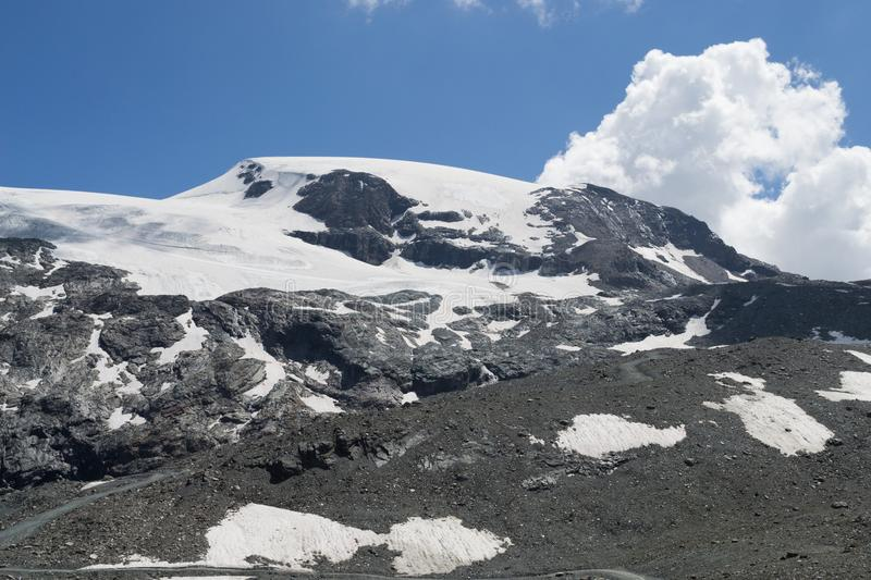 Snow on mountains in summer stock image