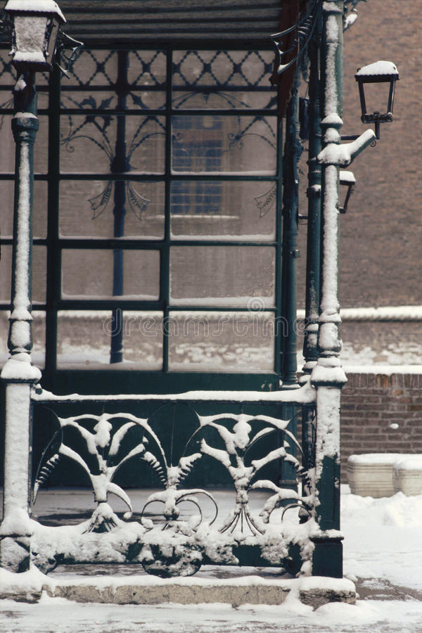 Snow in old town. Snow on antique gate and streetlamps royalty free stock photos