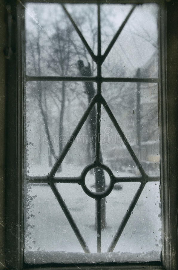 Snow on the old window stock image